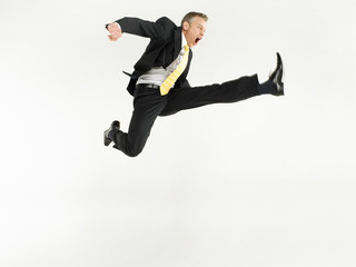 Business man jumping, full length