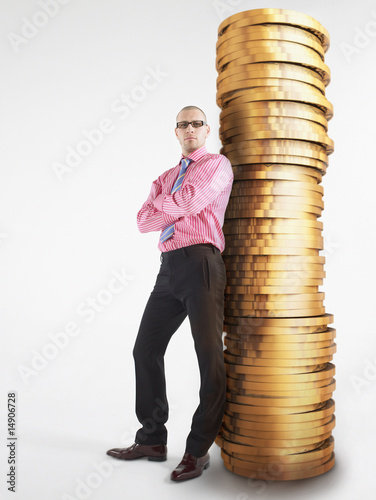 Man in glasses leaning against pile of coins, digital composite