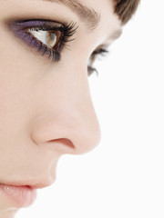 Young Woman Wearing heavy Eye Makeup, side view, close up
