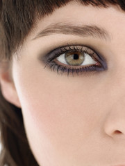 Eye of young woman wearing make-up, close up
