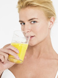 Young Woman in underwear Drinking Orange Juice, portrait