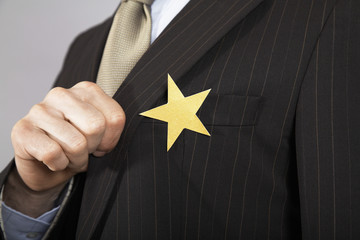 Businessman with gold star on suit, close-up