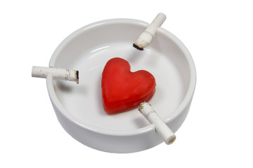 Cigarette stubs and a heart in a white ash-tray