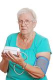 Closeup senior woman use automatic blood pressure poster