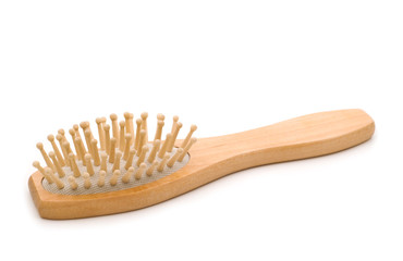 Natural wood massage hairbrush over white background
