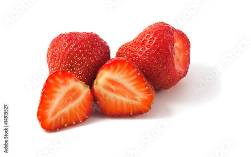 Fresh strawberries. One halved. Macro photo.