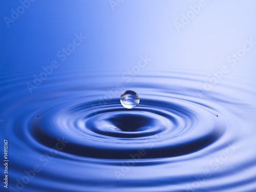 Drop hitting surface of water, close-up