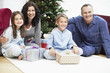 Happy Family in Front of Christmas Tree, portrait
