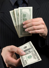 businessman holds money in hands