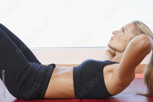 Woman Doing Sit-Ups, close up, side view