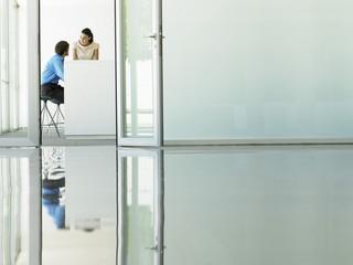 Businessmen Meeting viewed through open office door
