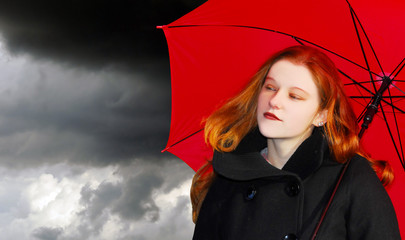girl with red hair and umbrella
