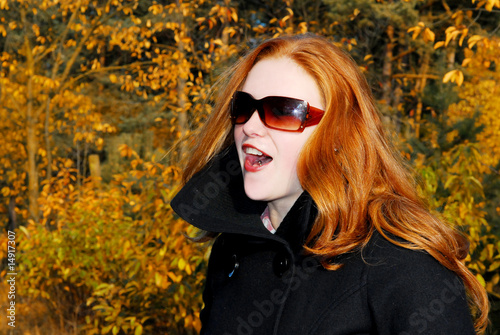 girl with red hair and sunglasses