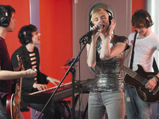 Rock Band Performing in Studio