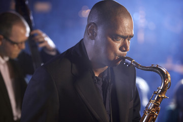 Saxophone player on stage, portrait