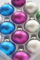 Christmas baubles in tray, close-up
