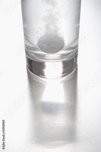 Tablet dissolving in glass of water