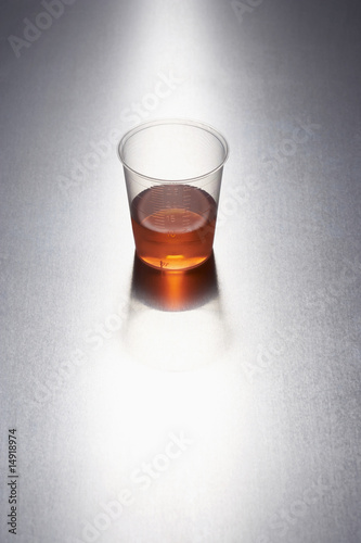 Medication in plastic cup
