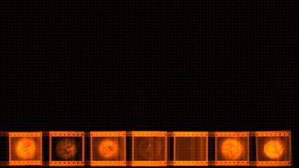 Orange celluloid film strip on grunge - digital animation