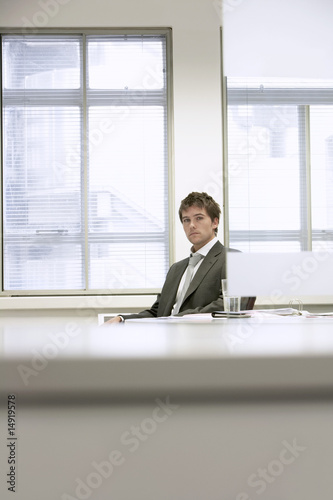 Tired Businessman sitting at desk in office