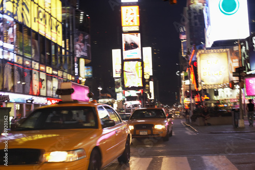 Yellow Taxis on City Street at Night