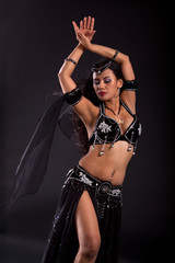 Exotic bellydancer in sexy black costume