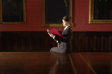 Woman Reading in Conference Room