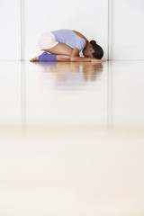 Dancer, crouching in prayer position