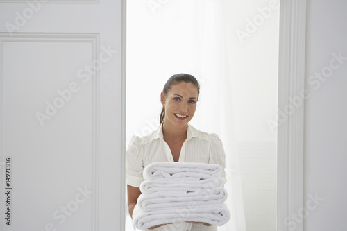 Housekeeper Bringing Towels