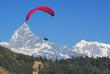Leinwandbild Motiv paraglide in nepal with himalaya background