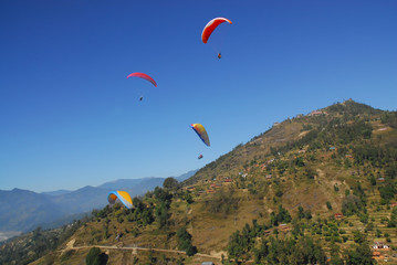4 paragliders with himalaya view in nepal