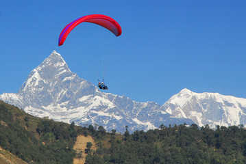 paraglide in nepal with himalaya background