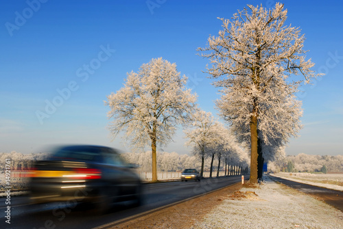 speeding car in dutch winter landscape