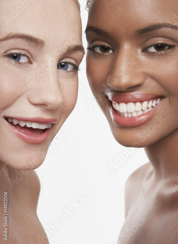 Two beautiful young women, smiling