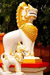 Generic lion guardian on stair of Buddhist church in Thailand