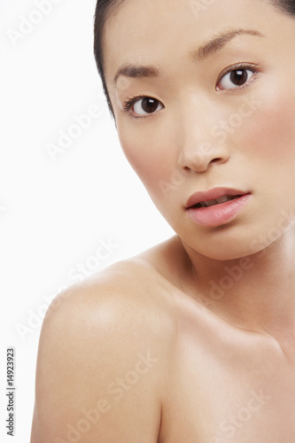 Young Asian woman, looking curious