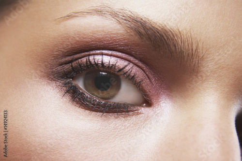 Young woman's eye with eye shadow