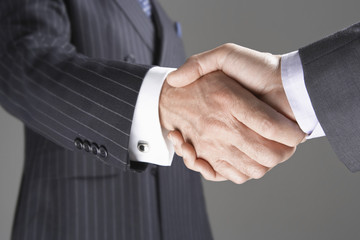 Businessmen Shaking Hands, close-up on hands
