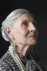 Senior Woman with Pearl Earrings, looking up