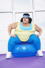 Overweight Woman Sitting on Exercise Ball