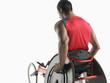 Paraplegic cycler, back view