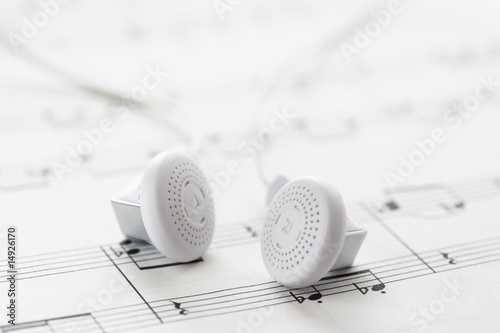 White headphones on sheet music