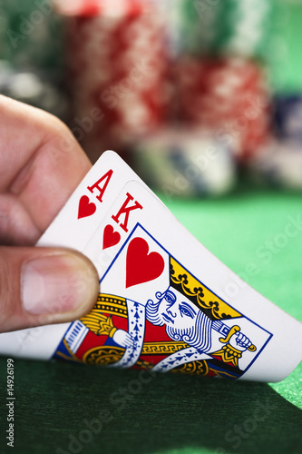 Man peeked at two cards, close up of hand