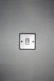 Silver light switch on wallpaper covered wall