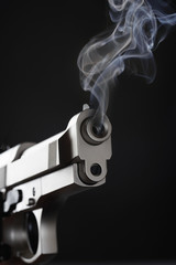 Smoking Handgun against black background