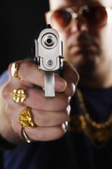 Man holding gun, focus on hand