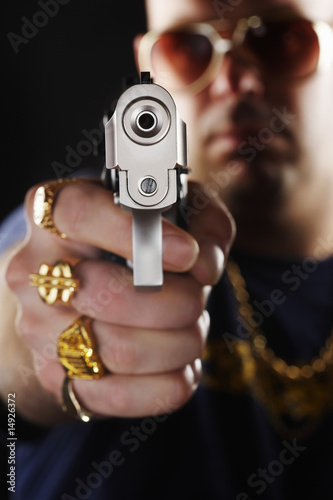 Man holding gun, focus on hand