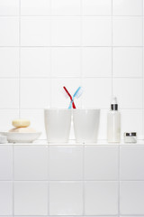 Still life of pair of toothbrushes conveying togetherness in white bathroom