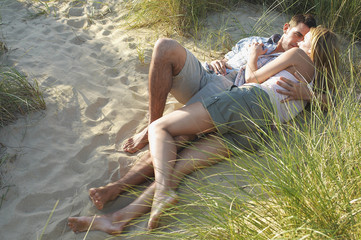 Couple lying and embracing in Secluded Spot on Beach, high angle view