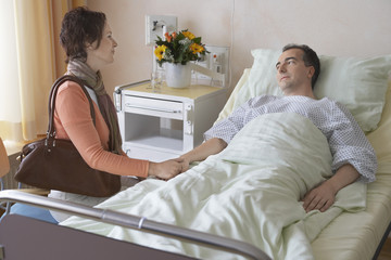 Woman Visiting Husband in Hospital